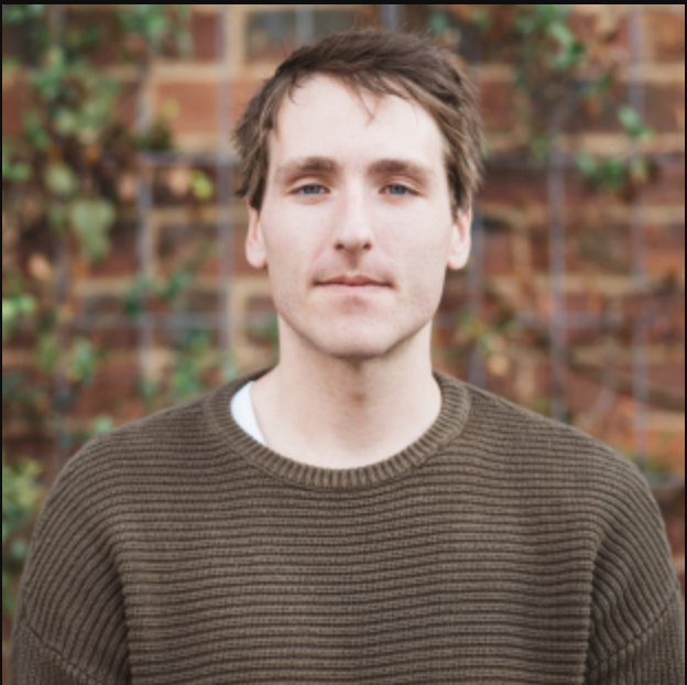 image of the author of this article Jake Linardon - A white male with short brown hair wearing a brown jumper.